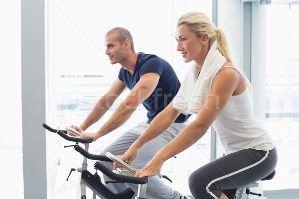 Határozott pár dolgozik testmozgás biciklik tornaterem Stock fotó © wavebreak_media