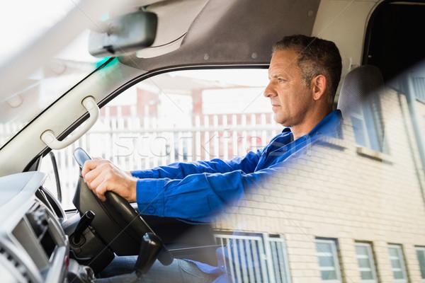 Serious delivery man driving his van Stock photo © wavebreak_media