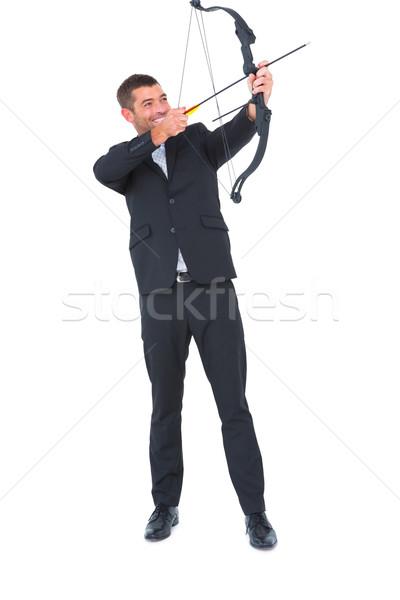 бизнесмен съемки лук стрелка белый человека Сток-фото © wavebreak_media