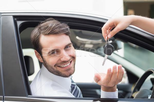 Businessman getting his new car key Stock photo © wavebreak_media