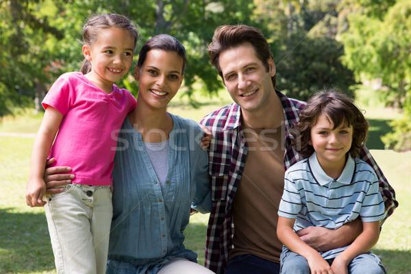 Happy family smiling at camera Stock photo © wavebreak_media