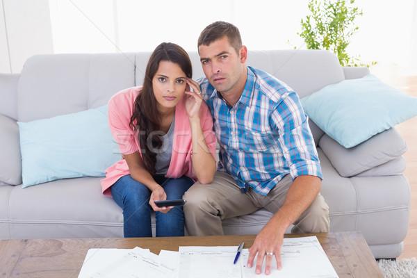 Portrait of worried couple calculating home finances Stock photo © wavebreak_media