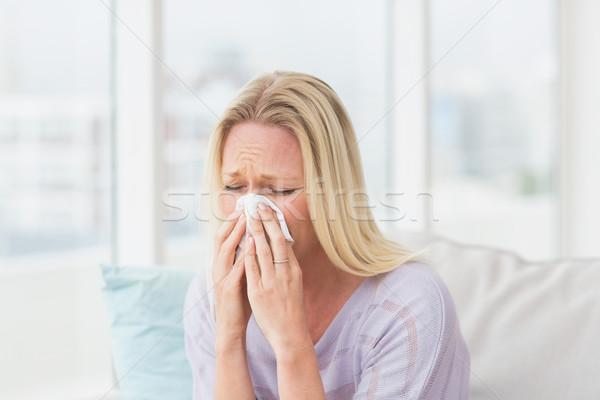 Woman sneezing in tissue Stock photo © wavebreak_media