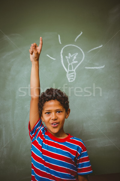 Little boy raising hand in classroom Stock photo © wavebreak_media