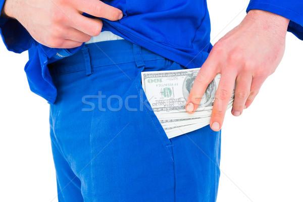Handyman dinheiro bolso branco mãos azul Foto stock © wavebreak_media