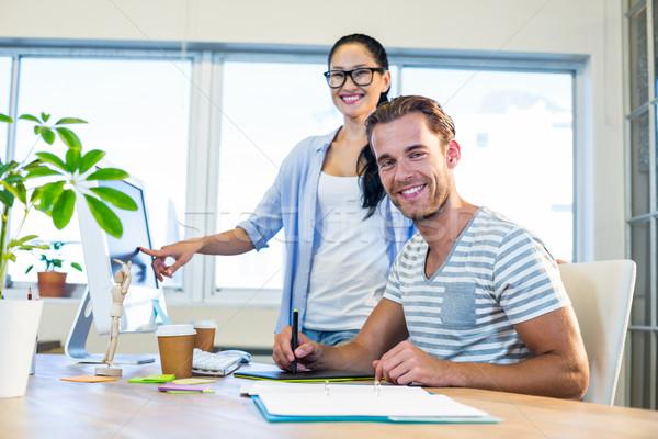 Smiling partners working together on computer and digitizer Stock photo © wavebreak_media