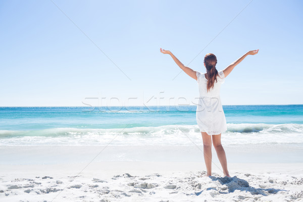 Pretty brunette standing arms outstretched  Stock photo © wavebreak_media