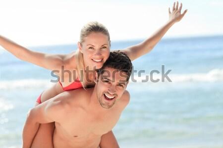 Przystojny mężczyzna powrót sympatia plaży kobieta Zdjęcia stock © wavebreak_media