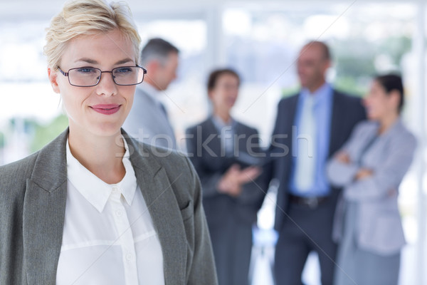 smiling businesswoman looking at the camera   Stock photo © wavebreak_media