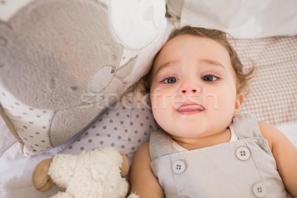 портрет ребенка кровать подушкой домой спальня Сток-фото © wavebreak_media