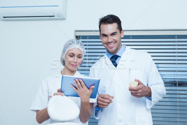 Dentists using digital tablet Stock photo © wavebreak_media
