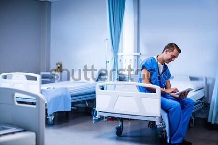 Doctor checking blood pressure of woman Stock photo © wavebreak_media