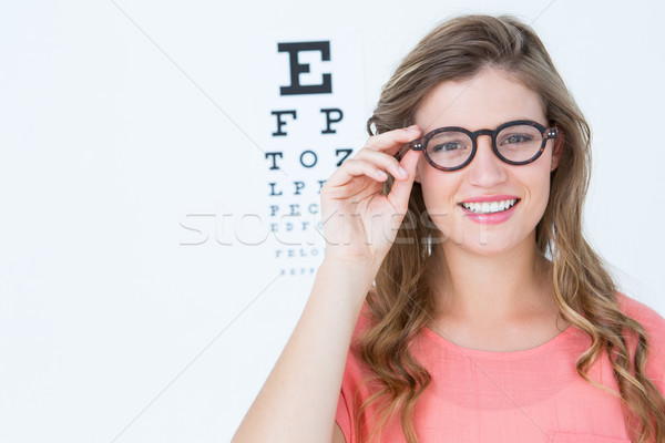 Pretty geeky hipster with glasses and eye test Stock photo © wavebreak_media