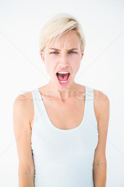 Angry blonde woman screaming  Stock photo © wavebreak_media