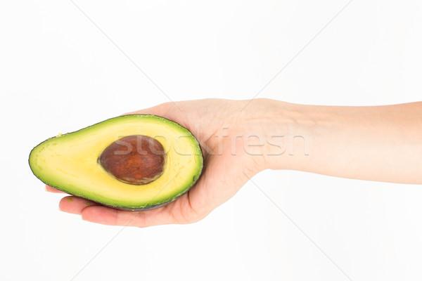Woman presenting half of an avocado  Stock photo © wavebreak_media