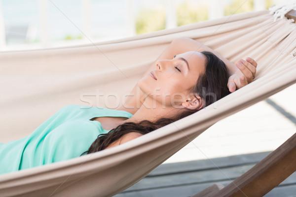 Csinos barna hajú megnyugtató függőágy belső udvar szabadság Stock fotó © wavebreak_media