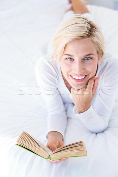 Mosolyog szőke nő ágy olvas könyv hálószoba Stock fotó © wavebreak_media