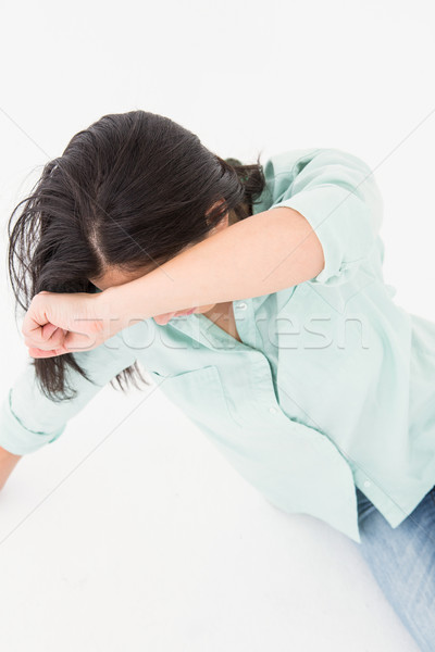 Sad woman sitting on the floor and hiding her face Stock photo © wavebreak_media