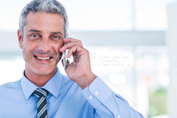 Gelukkig zakenman telefoongesprek kantoor telefoon man Stockfoto © wavebreak_media