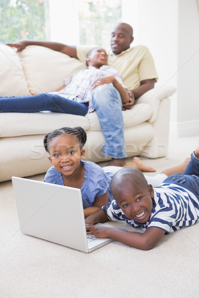 Happy siblings using their laptop Stock photo © wavebreak_media
