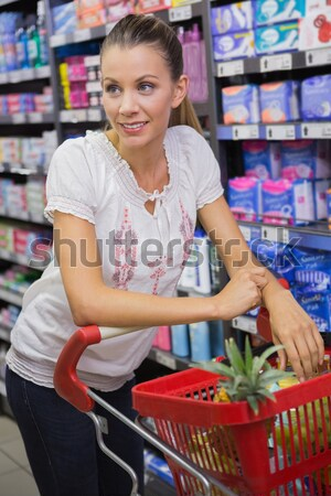 Smiling woman at cash register paying with credit card Stock photo © wavebreak_media