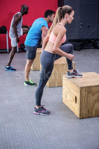 Three young Bodybuilders doing exercises Stock photo © wavebreak_media