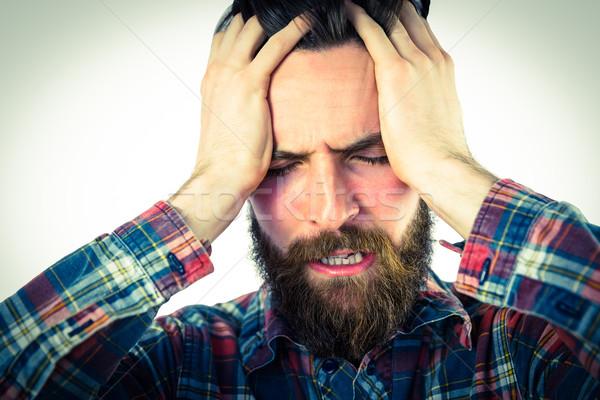 Handsome hipster getting a headache Stock photo © wavebreak_media