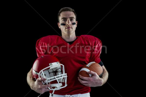 Amerikai futballista tart sisak labda piros Stock fotó © wavebreak_media