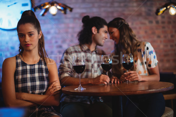 Jealous woman ignoring affectionate couple  Stock photo © wavebreak_media