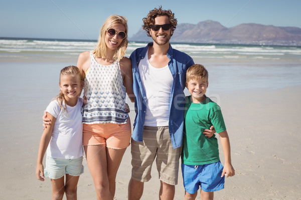 Portrait of happy family standing together at beach Stock photo © wavebreak_media