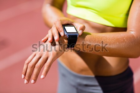 Woman wearing arm band and smart watch at beach Stock photo © wavebreak_media