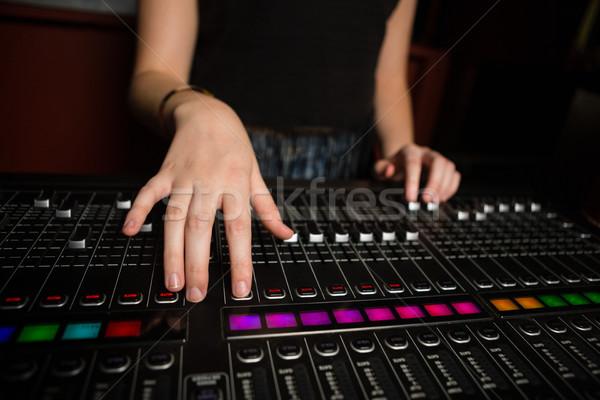 Mid-section of female audio engineer using sound mixer Stock photo © wavebreak_media