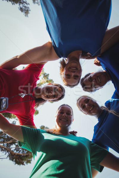 Group of women forming huddles in the boot camp Stock photo © wavebreak_media