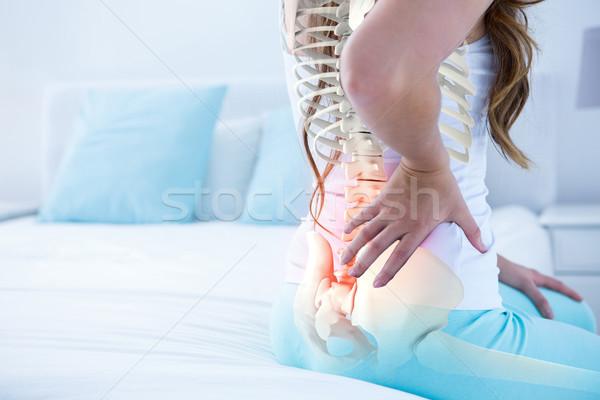 Digital composite Wirbelsäule Frau Rückenschmerzen home Bett Stock foto © wavebreak_media