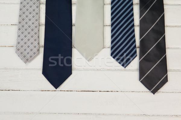 Various ties arranged on wooden plank Stock photo © wavebreak_media