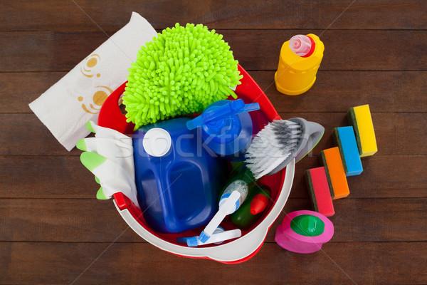 Bucket with cleaning supplies on wooden floor Stock photo © wavebreak_media