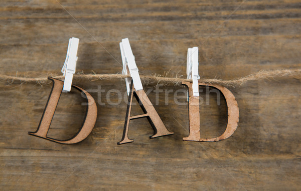 Close up of dad text hanging on string Stock photo © wavebreak_media