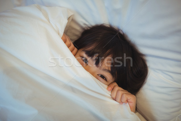 Boy hiding in bed under the blanket Stock photo © wavebreak_media