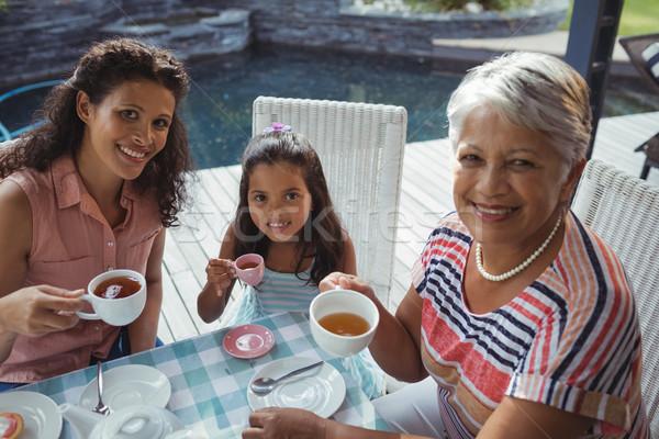 Happy family having tea Stock photo © wavebreak_media