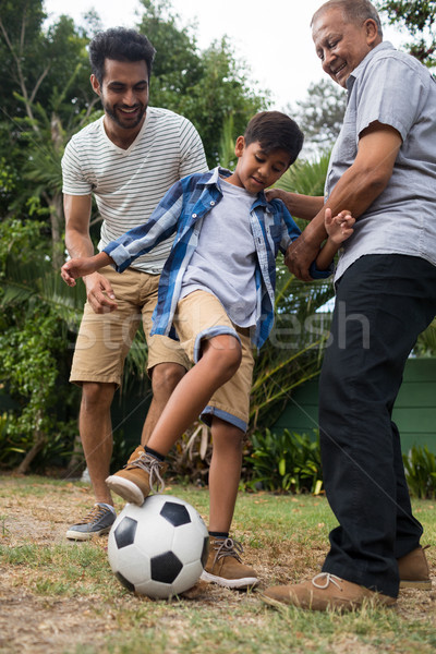 Low angle view of family playing soccer in yard Stock photo © wavebreak_media
