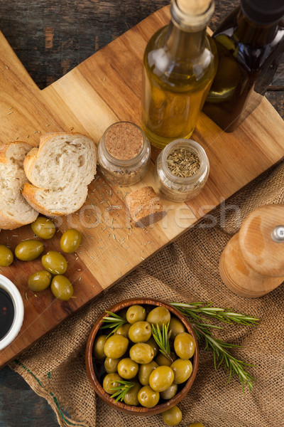 High angle view of olives and oils bottles with bread Stock photo © wavebreak_media