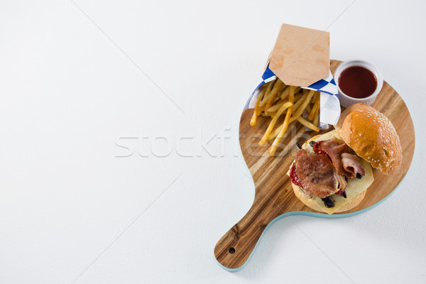 High angel view burger and French fries with tomato sauce Stock photo © wavebreak_media