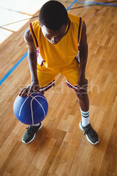 Stock photo: High angle view teenage boy practicing basketball