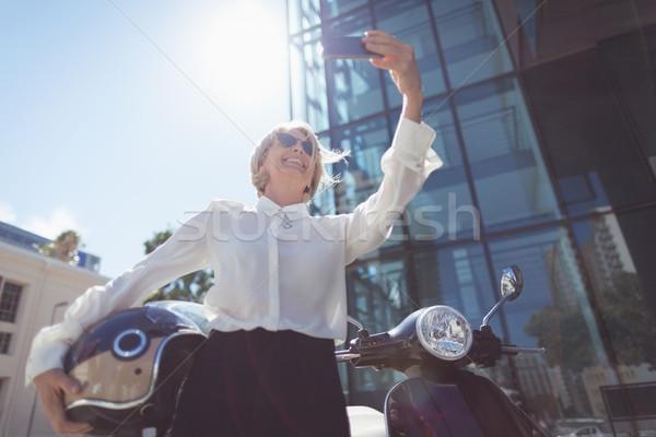 Businesswoman taking selfie Stock photo © wavebreak_media