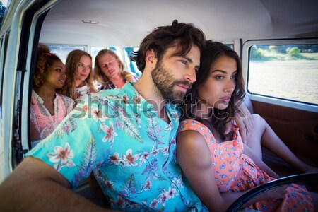 Portrait of smiling friends sitting in camper van Stock photo © wavebreak_media