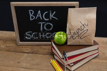 Fournitures scolaires pomme table en bois fruits fenêtre Photo stock © wavebreak_media