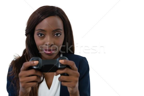 Portrait femme d'affaires jouer jeu vidéo blanche Photo stock © wavebreak_media