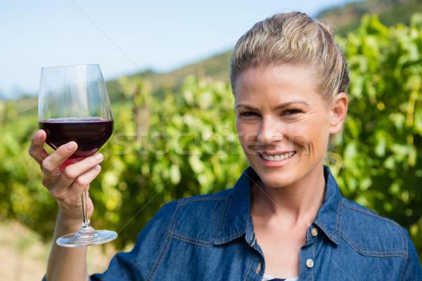 Portrait of female vintner holding glass of wine Stock photo © wavebreak_media