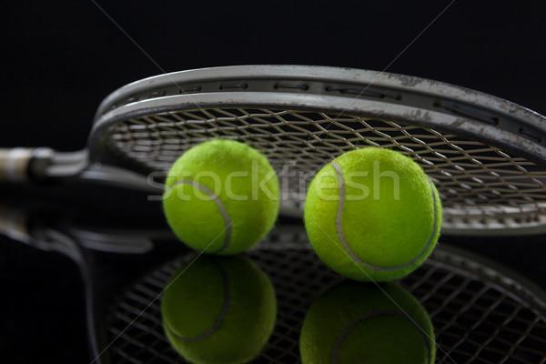 Close up of fluorescent yellow tennis balls with racket Stock photo © wavebreak_media