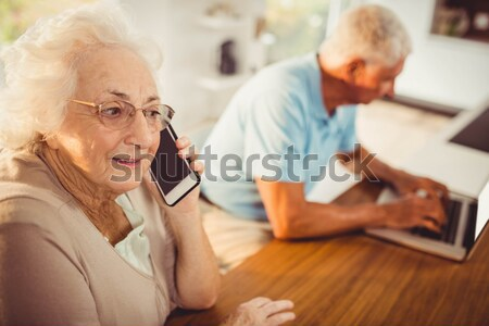 Senior man talking to female doctor in nursing home Stock photo © wavebreak_media